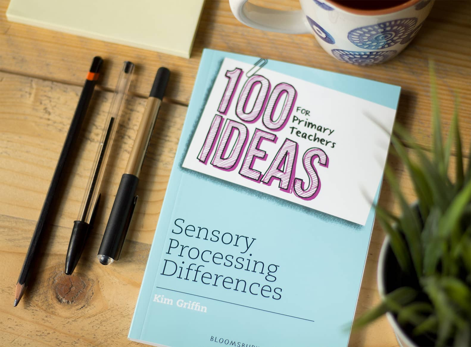 100 ideas for primary teachers sensory process book picture with pens beside it