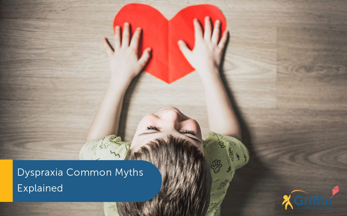 boy holding a love heart, text dyspraxia myths video