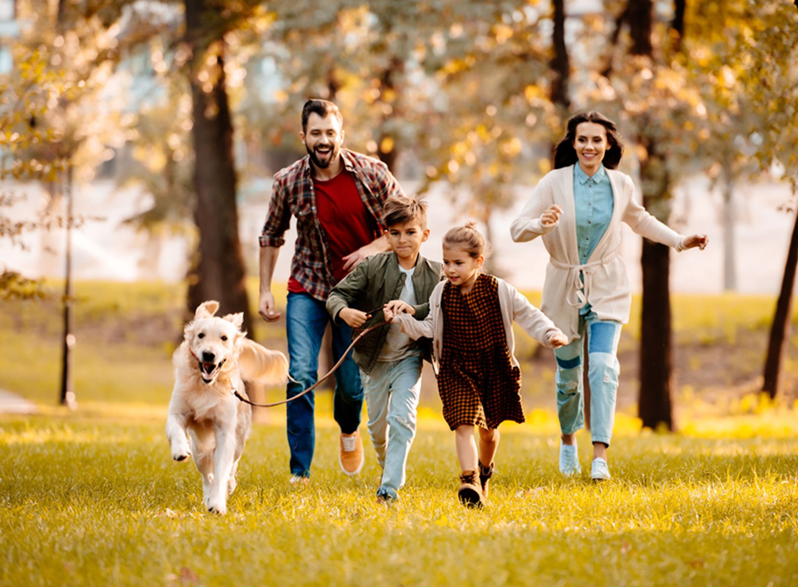 Family and their dog running