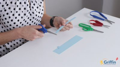 demonstrating using scissors with thumbs facing the ceiling