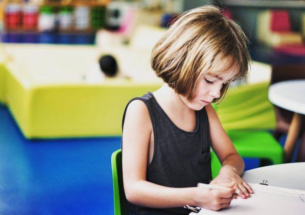 child writing teaching handwriting