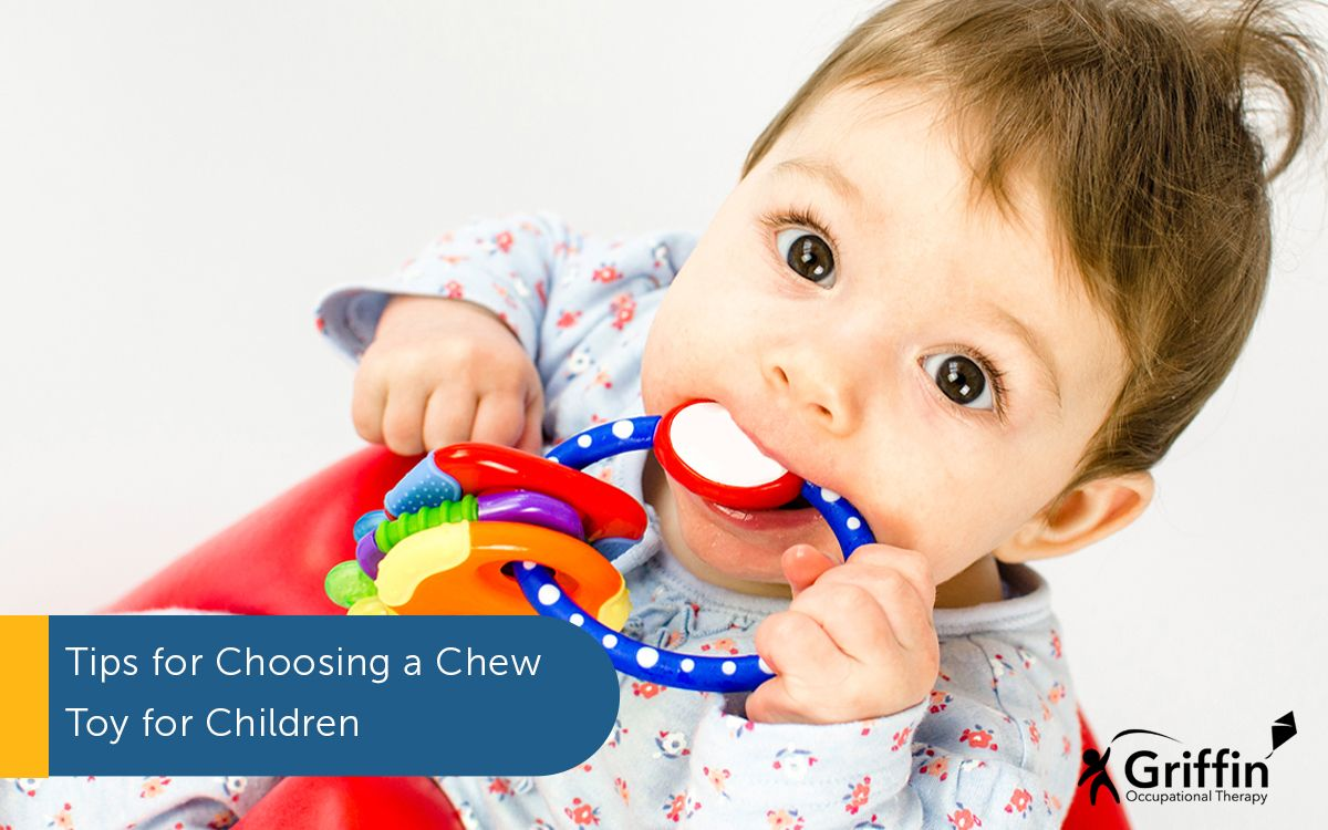 child sucking a chew toy text tips for choosing sensory chew toys for children