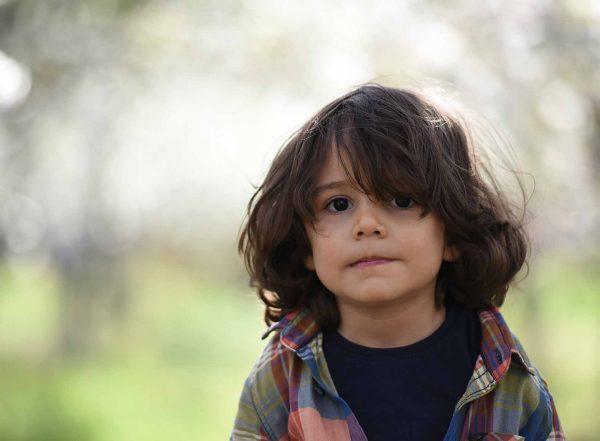 small boy looking at camera