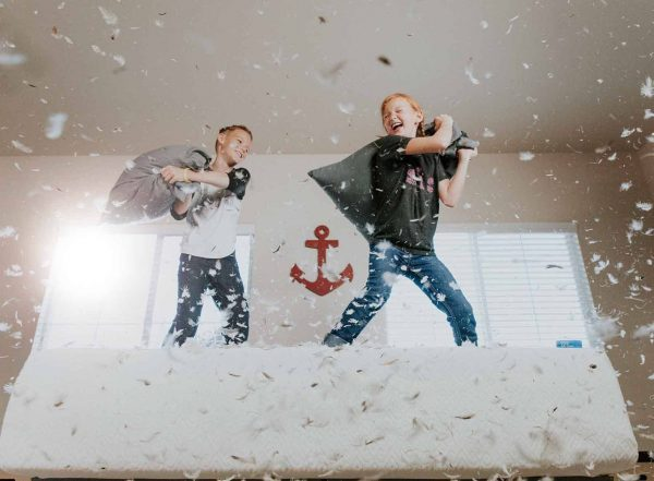 children having a pillow fight text the mystery of heavy work