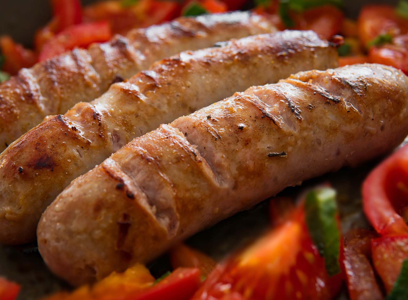 sausages and tomato on a plate