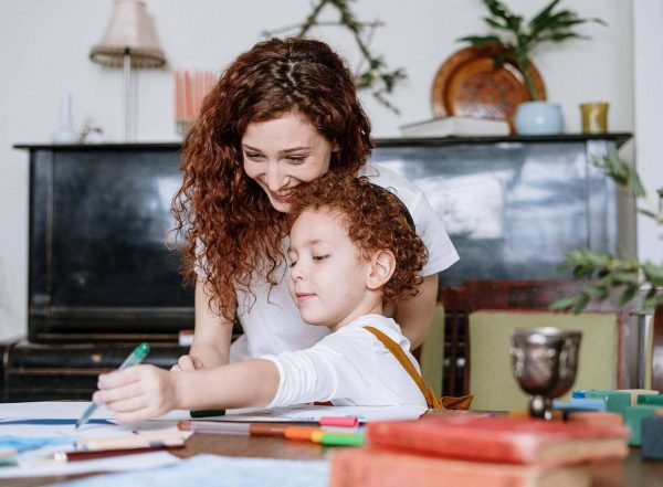 mother and child writing