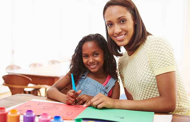 Mother and daughter drawing and painting fine motor skills