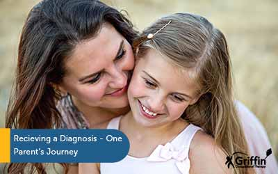 mother kissing daughter on the cheek text receiving a diagnosis of autism for our daughter