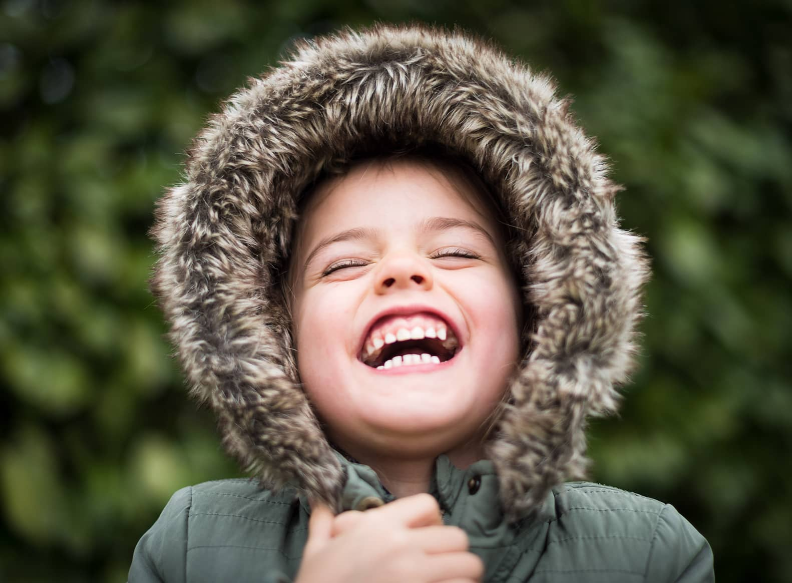 boy with jacket hood over head laughing text what is arousal