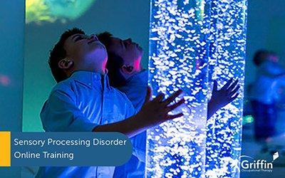 boy with sensory bubble tube text sensory processing disorder training