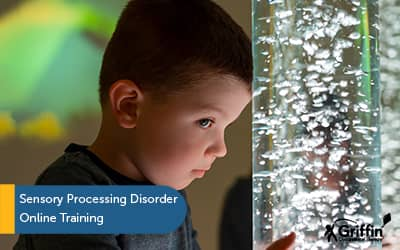 Boy standing at bubble tube text Sensory Processing Disorder Training with GriffinOT