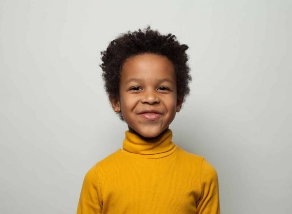 boy smiling directly at camera sensory strategies in the classroom