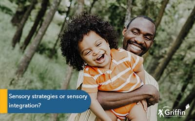 father holding child up, smiling, text sensory strategies