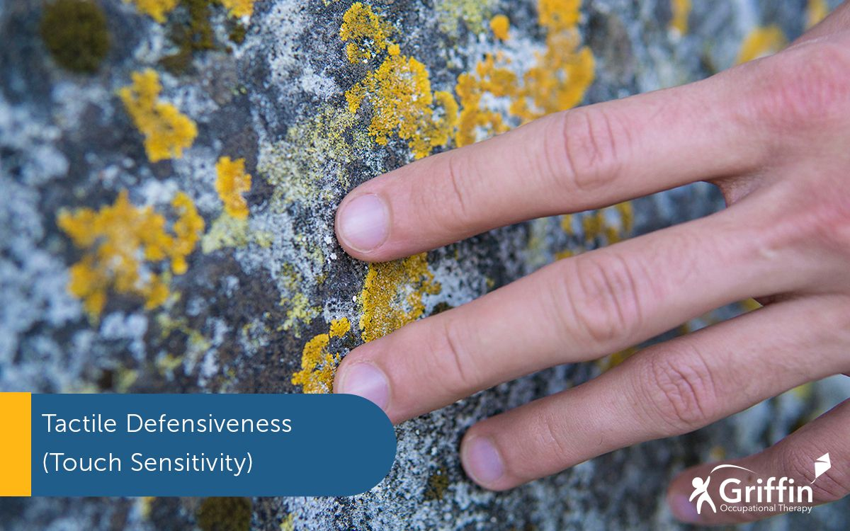 hand touching stone text touch sensitivity tactile defensiveness