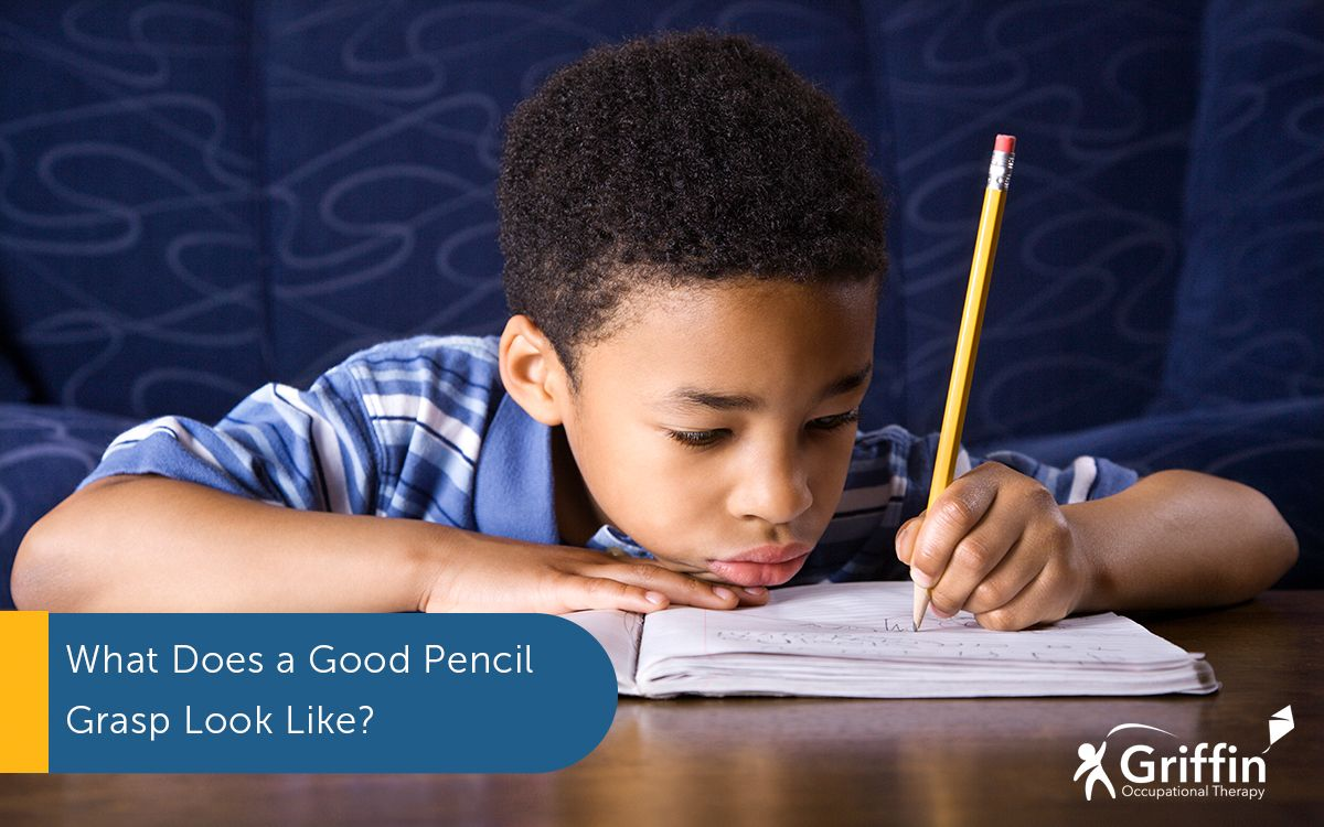 boy writing and text what does a good pencil grasp look like