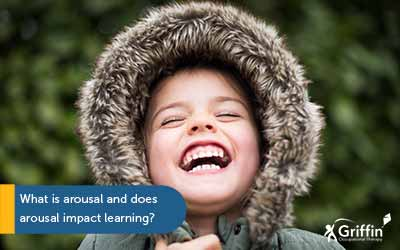 boy with jacket hood over head laughing text what is arousal and does arousal impact learning?