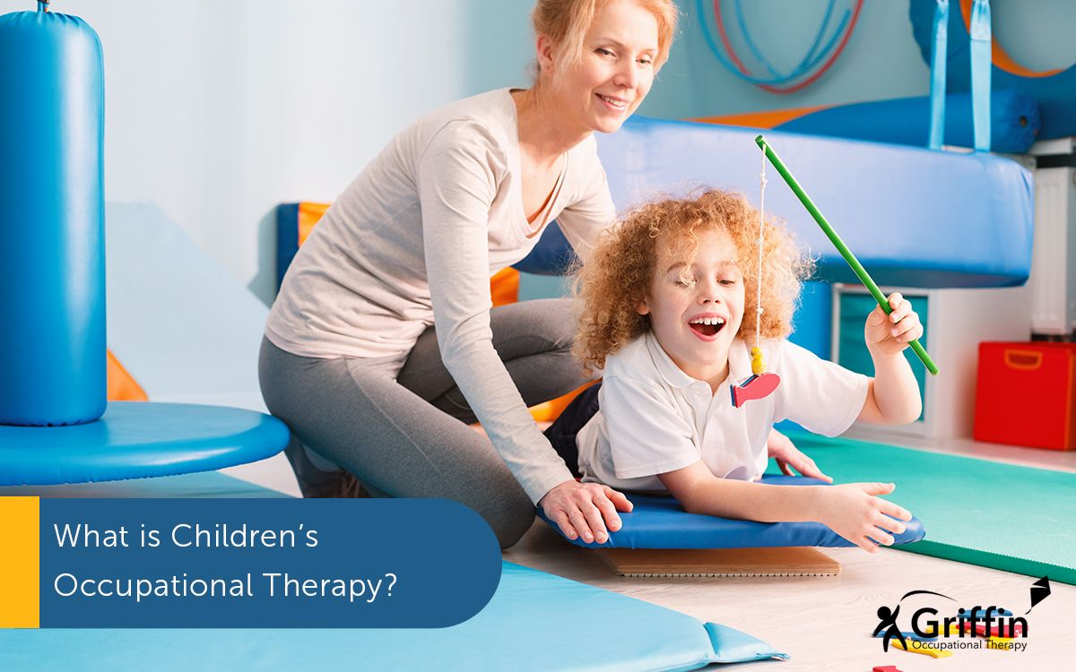 occupational therapist pushing a child on a swing text what is a children's occupational therapist