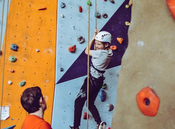 children rock climbing on ropes text heavy work example