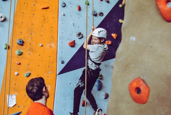 child rock climbing heavy work