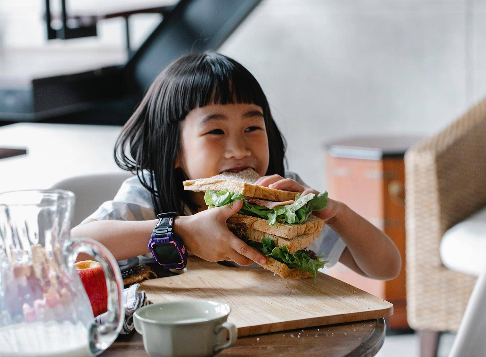 child eating sandwich 'hangry'