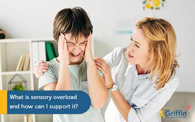 child with hands up to head and mother trying to comfort text what is sensory overload and how can i support it